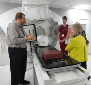 Radiotherapy Unit Staff explaining the operation of the CT Scanner to RadCan Trustees